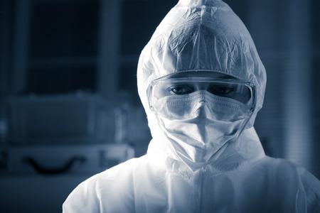 Foto de Researcher wearing hazmat protective suit and safety goggles. - Imagen libre de derechos