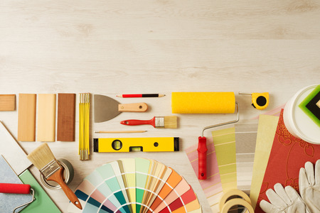 Foto de Decorating and DIY hobby tools and color swatches with copy space on top, top view - Imagen libre de derechos