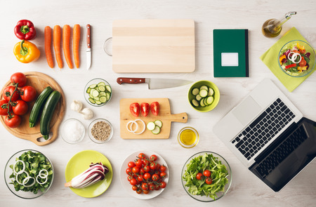 Photo pour Vegetarian creative cooking at home with kitchen utensils, food ingredients and fresh vegetables on a wooden table, top view - image libre de droit