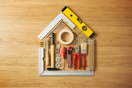 Foto de Conceptual house composed of DIY and construction tools on hardwood flooring, top view - Imagen libre de derechos