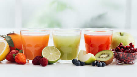 Photo for Glasses with fresh colorful juices and organic fruit, healthy diet and nutrition concept - Royalty Free Image
