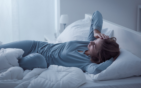Photo pour Depressed woman awake in the night, she is exhausted and suffering from insomnia - image libre de droit