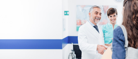 Photo for Doctor and female patient meeting at the hospital and shaking hands, healthcare and medicine banner - Royalty Free Image