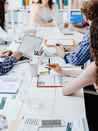 Photo for Business people meeting in the office, they are discussing financial strategies and checking financial reports - Royalty Free Image