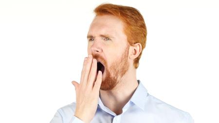 Foto de Tired businessman yawning against a white background - Imagen libre de derechos