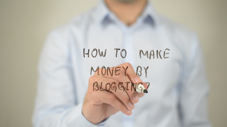 Foto de How To Make Money By Blogging , man writing on transparent screen - Imagen libre de derechos