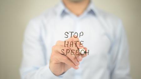 Photo pour Stop Hate Speech , man writing on transparent screen - image libre de droit
