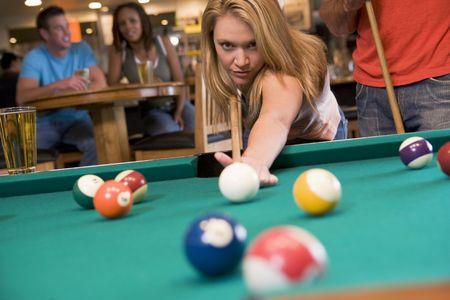 Woman playing pool