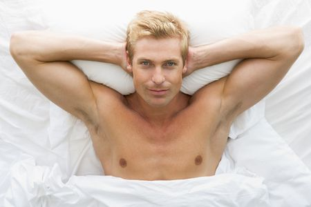 Man lying in bed relaxing