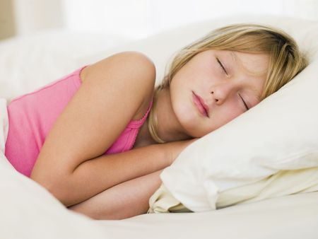 Young Girl Lying In Her Bed