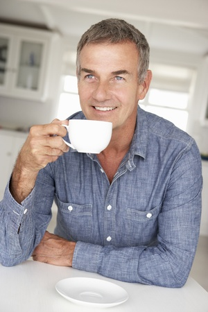 Photo for Mid age man with coffee at home - Royalty Free Image