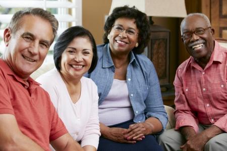 Photo pour Portrait Of Senior Friends At Home Together - image libre de droit
