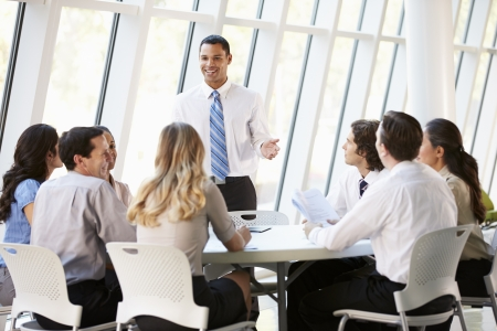 Photo pour Business People Having Board Meeting In Modern Office - image libre de droit