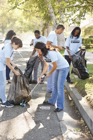 Photo for Team Of Volunteers Picking Up Litter In Suburban Street - Royalty Free Image