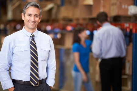 Photo pour Portrait Of Manager In Warehouse - image libre de droit