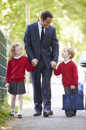 Photo for Father Walking To School With Children On Way To Work - Royalty Free Image