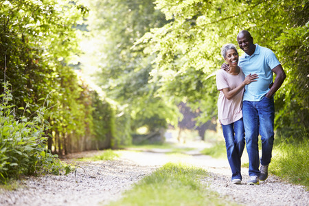 Photo for Mature African American Couple Walking In Countryside - Royalty Free Image