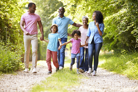 Photo pour Multi Generation African American Family On Country Walk - image libre de droit