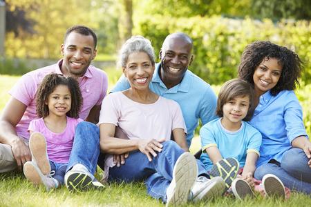 Photo pour Multi Generation African American Family Sitting In Garden - image libre de droit