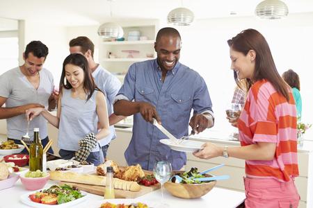 Foto de Group Of Friends Having Dinner Party At Home - Imagen libre de derechos