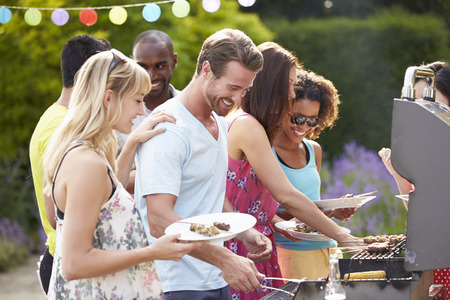Photo for Group Of Friends Having Outdoor Barbeque At Home - Royalty Free Image