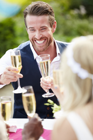 Photo for Friends Proposing Champagne Toast At Wedding - Royalty Free Image