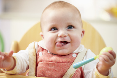 Photo for Portrait Of Happy Young Baby Boy In High Chair - Royalty Free Image