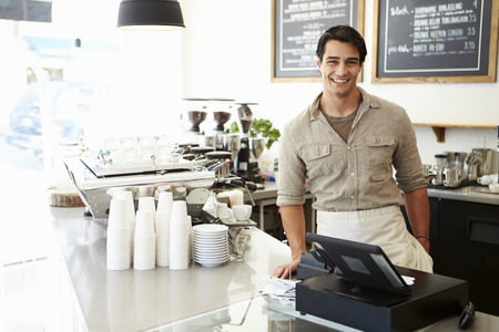 Photo pour Male Owner Of Coffee Shop - image libre de droit