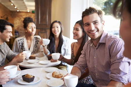 Photo for Group Of Friends Meeting In Café Restaurant - Royalty Free Image