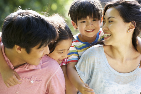 Photo for Asian Family Enjoying Walk In Summer Countryside - Royalty Free Image