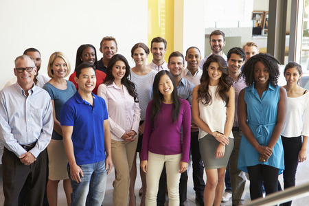Photo for Portrait Of Multi-Cultural Office Staff Standing In Lobby - Royalty Free Image