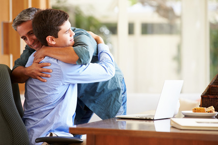 Photo for Father And Teenage Son Having A Hug - Royalty Free Image