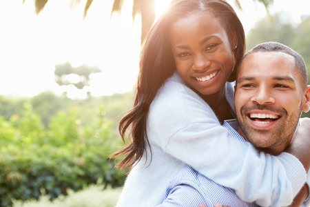 Portrait Of Loving African American Couple In Countryside