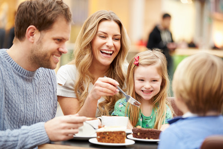 Photo for Family Enjoying Snack In Cafe Together - Royalty Free Image