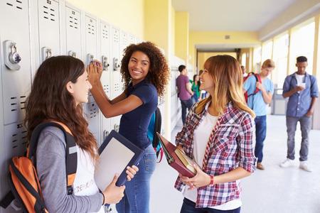 Photo pour Group Of Female High School Students Talking By Lockers - image libre de droit