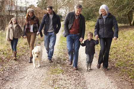 Foto de Multi Generation Family On Countryside Walk - Imagen libre de derechos