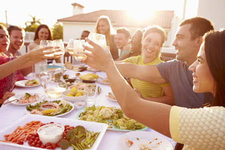 Photo for Group Of Young People Enjoying Outdoor Summer Meal - Royalty Free Image
