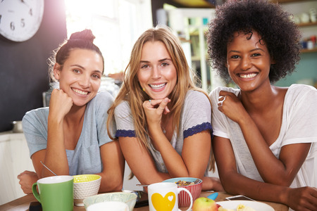 Photo for Three Female Friends Enjoying Breakfast At Home Together - Royalty Free Image