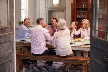 Photo for Group Of Friends Enjoying Meal At Home Together - Royalty Free Image