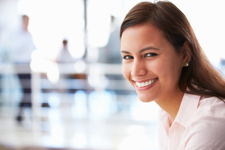 Photo for Portrait of smiling woman in office - Royalty Free Image