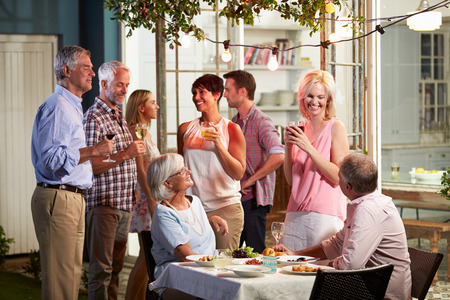 Photo for Group Of Friends Enjoying Outdoor Evening Drinks Party - Royalty Free Image