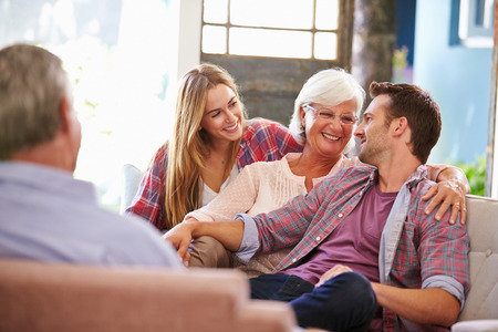 Photo for Family With Adult Children Relaxing On Sofa At Home Together - Royalty Free Image