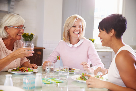 Photo for Group Of Mature Female Friends Enjoying Meal At Home - Royalty Free Image