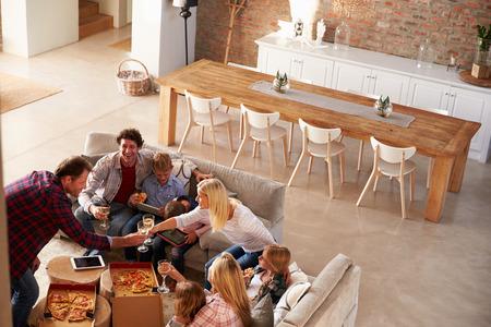 Photo pour Two families spending time together at home - image libre de droit