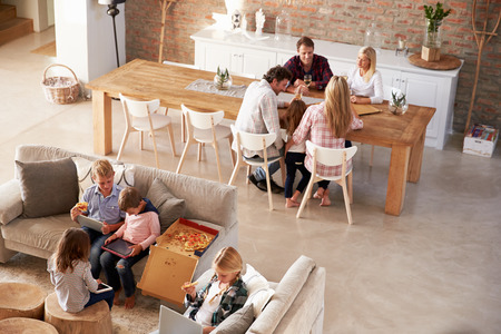 Photo for Two families spending time together at home - Royalty Free Image