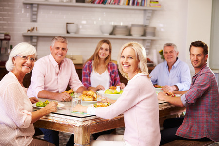 Photo for Portrait Of Friends Enjoying Meal At Home Together - Royalty Free Image