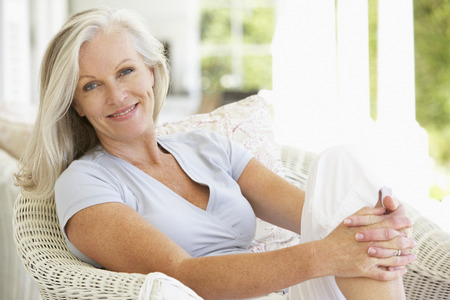 Photo for Senior Woman Sitting Outside - Royalty Free Image