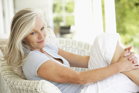 Foto per Senior Woman Sitting Outside - Immagine Royalty Free