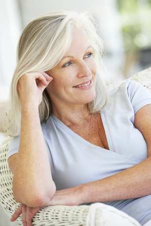 Foto per Portrait Of Senior Woman Relaxing In Chair - Immagine Royalty Free