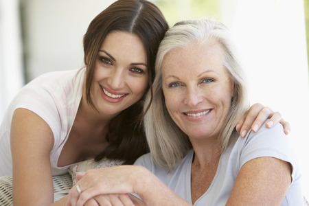 Photo for Mature Mother And Daughter Hugging - Royalty Free Image